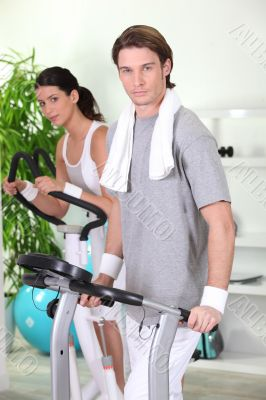 Man and woman working out in a gym