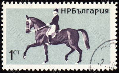 Horse with rider on post stamp