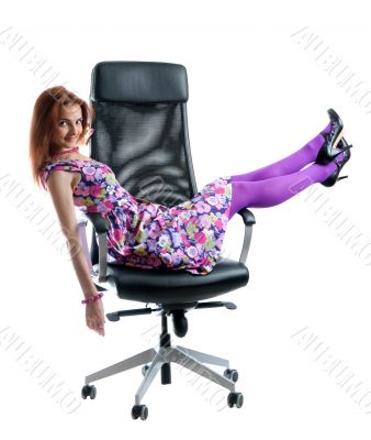 Beautiful girl on black easy chair