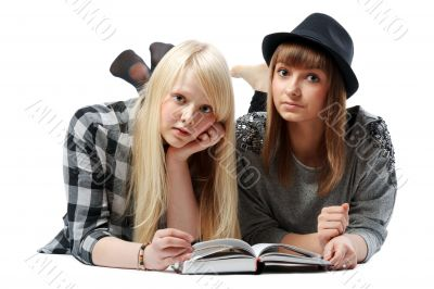Two girls lies and read books