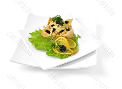 Salad with crab meat in a basket