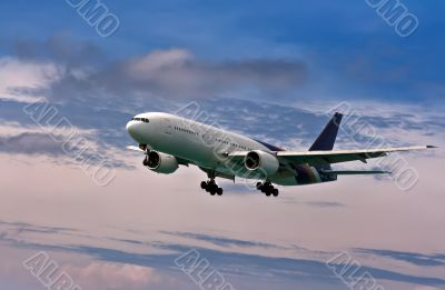 passenger plane comes in to land on a blue sky