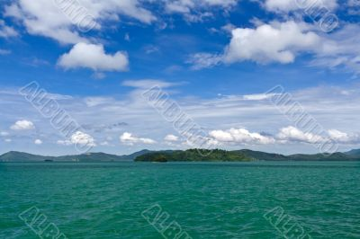 Landscape of palm island on the horizon in the Andaman Sea