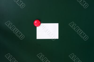 Blank stick note on a green board