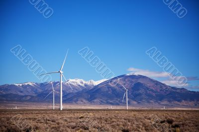 Power mills field in front of the mountain range