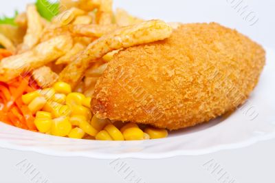Chicken Kiev with corn and french fries