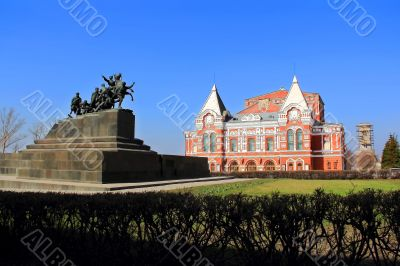 Landscape with historic theater and blue sky