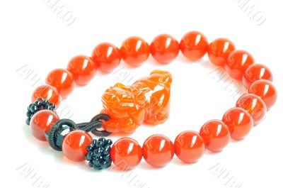 Red jade prayer beads on a white background
