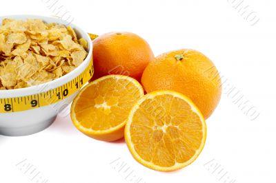 cropped corn flakes bowl and orange fruit