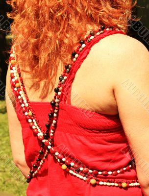 Women`s beads on the red background
