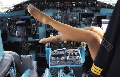 Legs of woman in the cockpit