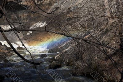 rainbow above flowing water