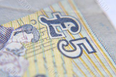 Five pound sterling