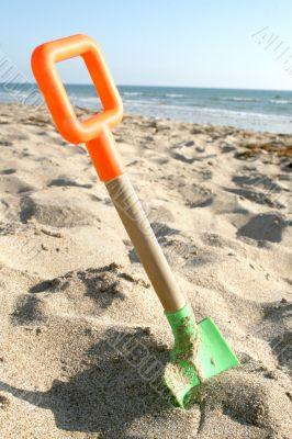 Beach Shovel on sand