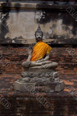 Buddha statue holding a plumeria flowers
