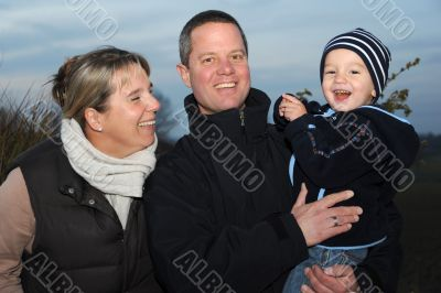 Family picture - parents with 2 year old son -