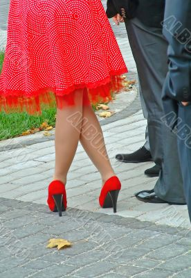Legs in red shoes