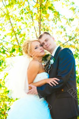 Bride and groom at the park