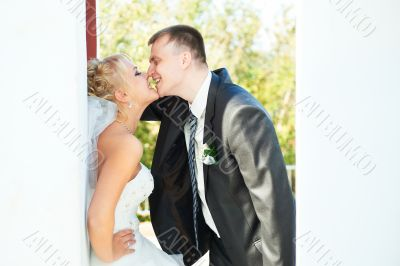 Bride and groom posing on a white background