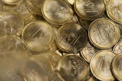 Euro coins drown in water and fog