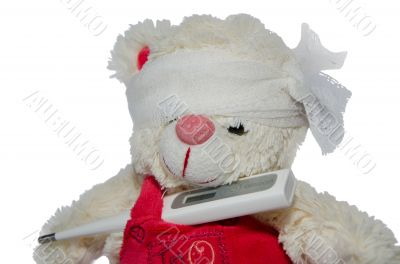 Teddy bear and a thermometer