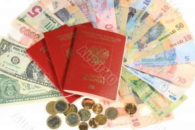 .Many banknotes of different countries and the passport for travel.