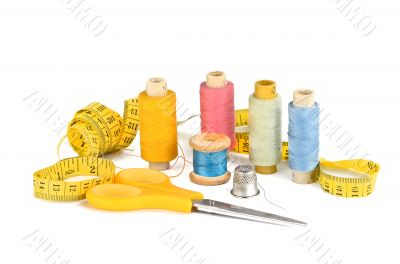 Thread, scissors, inch and a thimble