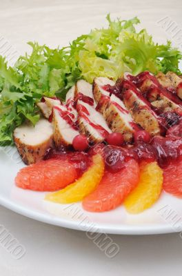 Sliced baked fillet with cranberry sauce