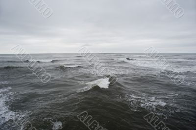 The stormy waves of the North Sea in a cloudy day