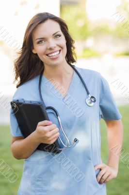 Young Adult Woman Doctor or Nurse Holding Touch Pad