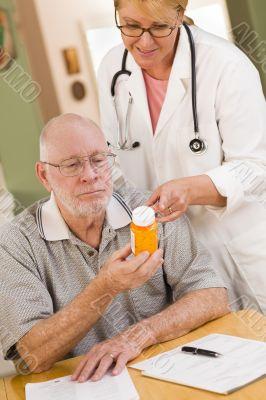 Doctor or Nurse Explaining Prescription Medicine to Senior Man