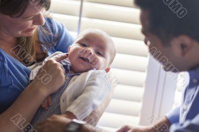 Mixed Race Couple Enjoying Their Newborn Son