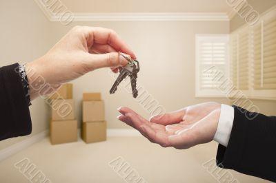 Agent Handing Over the House Keys Inside Empty Tan Room