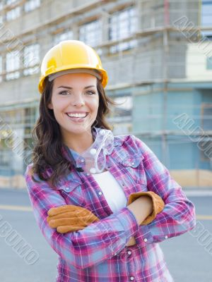 Young Attractive Female Construction Worker Wearing Hard Hat and