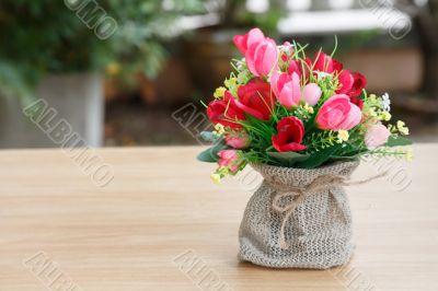 Decorative flower on wooden desk