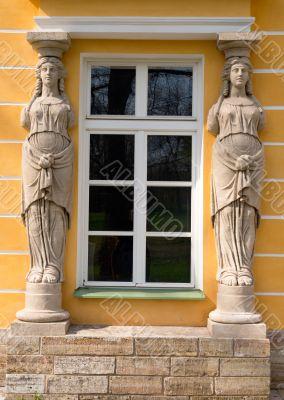window with sculptures