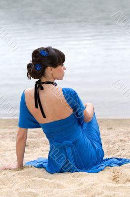 girl in a blue dress sitting