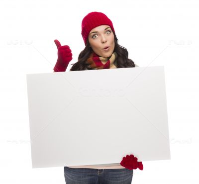 Excited Girl Holds Blank Sign and gives Thumbs Up Gesture