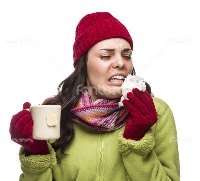 Sick Mixed Race Woman Drinks Hot Tea While Blowing Nose