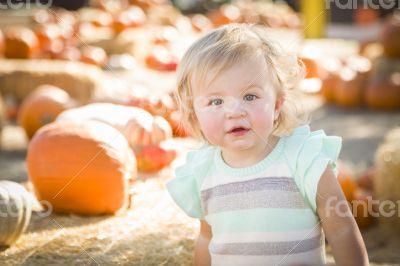 Adorable Baby Girl Having Fun at the Pumpkin Patch