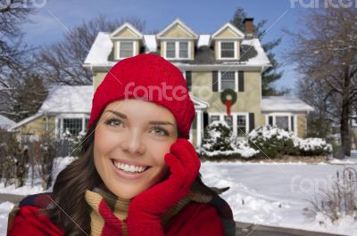 Smiling Mixed Race Woman in Winter Clothing Outside in Snow