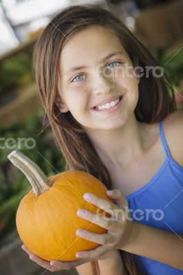 Pretty Young Girl Having Fun with the Pumpkins at Market