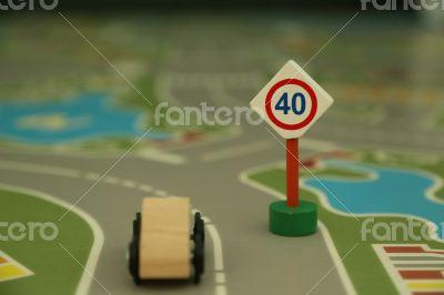 mini wooden road sign `speed limit 40`