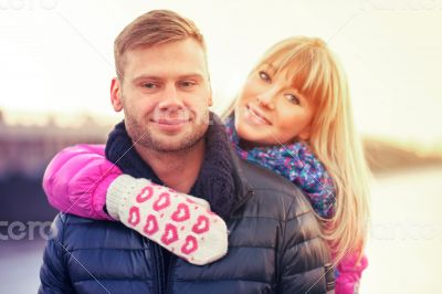 Woman in lovely mittens and her boyfriend