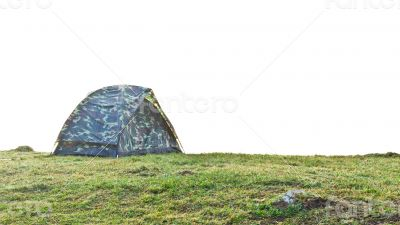 Tent camping at grass on the hill in morning.