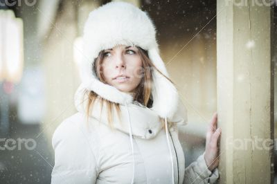 Winter girl in warm clothes snowy day
