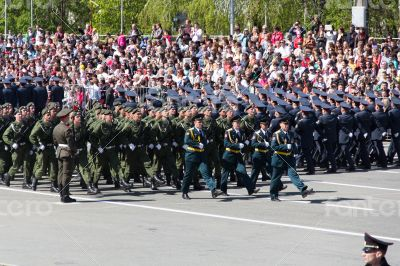 Russian soldiers march at the parade