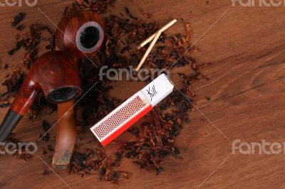 The Tabacco Pipe On The Wood Unhealthy
