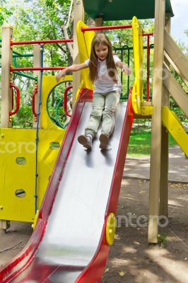 Active girl on nursery platform in summer