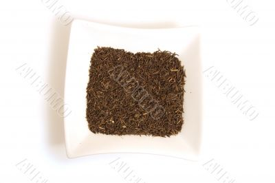black cumin seeds in square white bowl isolated